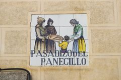 Signs of street names are created from ceramic tiles with a picture illustrating the name of the street. MADRID, SPAIN - 27 MARCH, 2018: Signs of street names Stock Photos