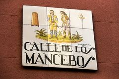 Signs of street names are created from ceramic tiles with a picture illustrating the name of the street. MADRID, SPAIN - 27 MARCH, 2018: Signs of street names Royalty Free Stock Images