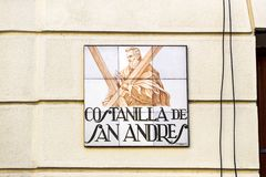 Signs of street names are created from ceramic tiles with a picture illustrating the name of the street. MADRID, SPAIN - 27 MARCH, 2018: Signs of street names Royalty Free Stock Photos
