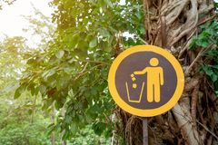 Signs suggest places for garbage dumping in parks.  stock photo