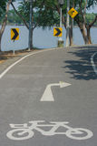The signs and symbols on bicycle path. Royalty Free Stock Photography