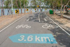 Signs and symbols on bicycle path. Stock Images
