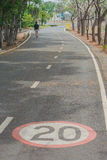 Signs and symbols on bicycle path. Signs and symbols on bicycle path at public park Stock Photo