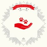 Hand holding paw symbol. Animal protection. Signs and symbols - graphic elements for your design Royalty Free Stock Photo