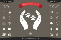 Shelter pets sign icon. Hands holds paw symbol. Animal protection. Signs and symbols - graphic elements for your design Stock Photos