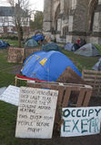 Signs and tents in the Occupy Exeter camp Royalty Free Stock Photos