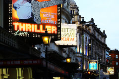 Signs of theaters in London. London, United Kingdom - January 2016: illuminated signs at dusk of some theaters performing shows. No people Royalty Free Stock Photo