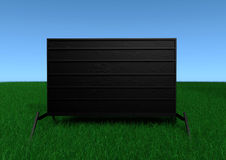 Signs Of Things 2. A portable outdoor sign with beautiful blue sky and green grass Royalty Free Stock Photo