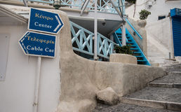 Signs to city center and the cable car in Fira Town Santorini Royalty Free Stock Photo