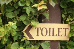 Signs to the toilet in the garden. Royalty Free Stock Photo