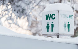Signs toilet in winter season Royalty Free Stock Photography