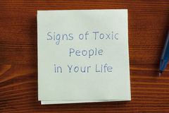 Signs of Toxic People in Your Life written on a note Stock Photos