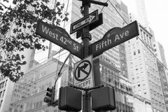 Signs and traffic light on the pole in black and white style, Manhattan, New York Stock Photos