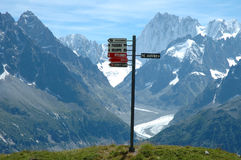 Signs on trail nearby Chamonix in Alps in France Stock Images