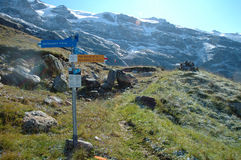 Signs on trail nearby Grindelwald in Switzerland. Royalty Free Stock Images