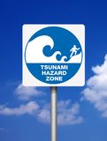 Signs Tsunami. Tsunami warning blue signs on blue sky background royalty free stock photos