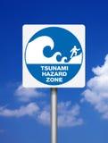 Signs Tsunami. Tsunami warning blue signs on blue sky background Royalty Free Stock Photos