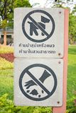 Signs warn pet. And do not litter. Royalty Free Stock Images