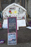 Signs and white tent in the Occupy Exeter camp Stock Photo