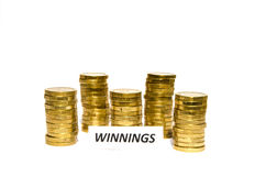 Winnings sign at coin piles Royalty Free Stock Images