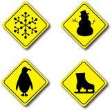 Signs of Winter. Street signs of winter objects: snow ahead, snowmen ahead, penguins ahead, and ice skating ahead Royalty Free Stock Images