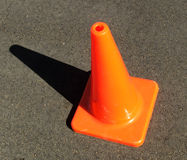Signs - Witches Hat. Bright orange witches hat on a bitumin road stock photos