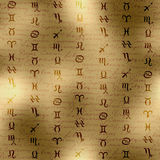 Signs of zodiac on manuscript background Stock Images