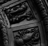 Signs of the zodiac. Shot in black and white, detail on some sculpture representing signs of the zodiac placed on the facade of this historic building, set in royalty free stock images