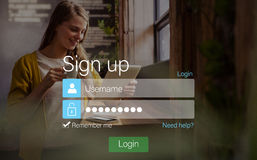 Signup screen with blonde girl and pad Stock Photo