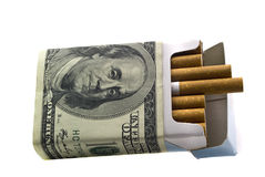 Sigorety in a pack with the money. Pack of cigarettes  the money Royalty Free Stock Photo