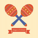 Sigue el ritmo. Poster with maracas and spanish text translated as follow the rhythm Stock Photo