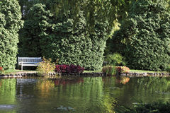 Sigurta charmingly picturesque garden. Shallow pond, and elegantly trimmed trees. Northern Italy Stock Images