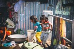 Cambodian kids play in slum village near Otres Beach in Sihanoukville Stock Photography