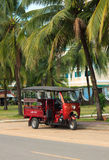 SIHANOUKVILLE, CAMBODIA - NOVEMBER 17, 2014. Tuk-tuk moto taxi parked on the street. Famous asian moto-taxi called tuk-tuk is a landmark of Asia and a popular Royalty Free Stock Photography