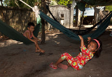 SIHANOUKVILLE, CAMBODIA - NOVEMBER 18, 2014. Unidentified poor cambodian children playing in hammocks Stock Photos