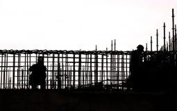 Sihouette建筑工作 免版税库存图片
