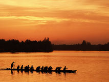 Sihouette boat view in sunset moment. A practicing race boat in river, sunset golden sky moment Royalty Free Stock Image