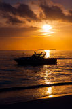 Sihouette yacht with sun set in Maldives Stock Photo