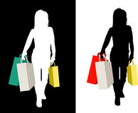 Sihouetted female shoppers. Female silhouette with shopping bags Stock Photography