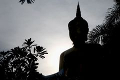 Sihuoette buddha statue in sunset royalty free stock photos