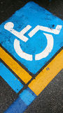Siignal handicap on asphalt. Symbol of the handicapped person painted on the asphalt Royalty Free Stock Photos