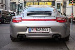 Siilver灰色保时捷911 Carrera 4汽车,背面图 免版税库存图片