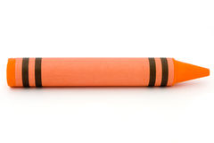 Siingle orange crayon isolated on white stock images