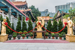 Sik Sik Yuen Wong Tai Sin Temple Kowloon Hong Kong. Golden statues at Sik Sik Yuen Wong Tai Sin Temple Kowloon in Hong Kong Royalty Free Stock Photos
