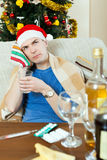 Sikc man in red New Year  hat  stuping  towel to head Stock Photos