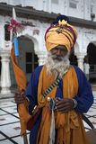 A Sikh man at the Golden Temple in Amristar, India. India, Amritsar, Sikh in traditional clothes at the Sri Harmandir Sahib or Golden Temple Stock Image