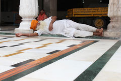 Sikh asleep in the Amritsar temple at Panjab. Need for siesta. Royalty Free Stock Photos