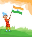 Sikh boy hoisting Indian flag Stock Photos
