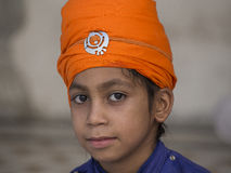 Sikh boy visiting the Golden Temple in Amritsar, Punjab, India. Stock Photo