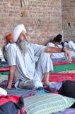 Sikh devotee. Resting at golden temple gurudwara at amritsar punjab india Stock Photo